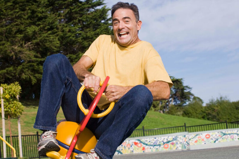Don't worry -- playgrounds designed for adults are fun and focused on fitness. You won't have to use kid-size equipment.   ©Getty Images/Jupiter Images/Thinkstock