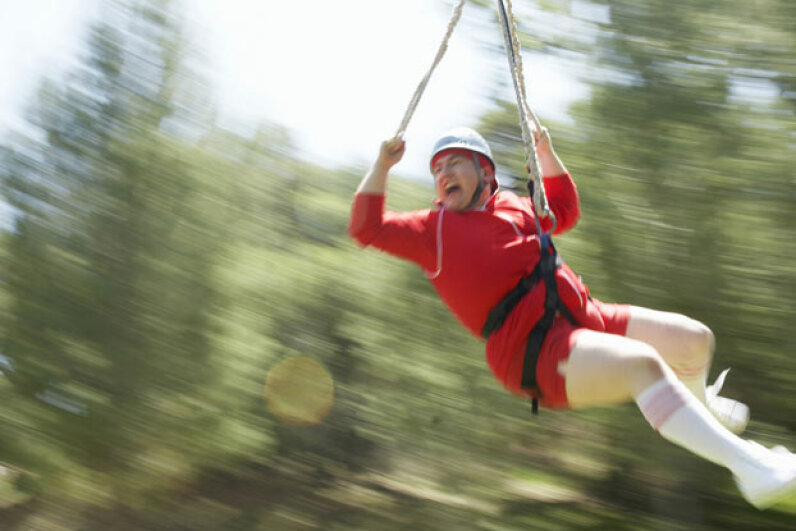 Even if you're screaming in fear on a zip line, you're still getting a great core workout -- and all that yelling might improve your lung capacity.  ©Sean Murphy/Thinkstock