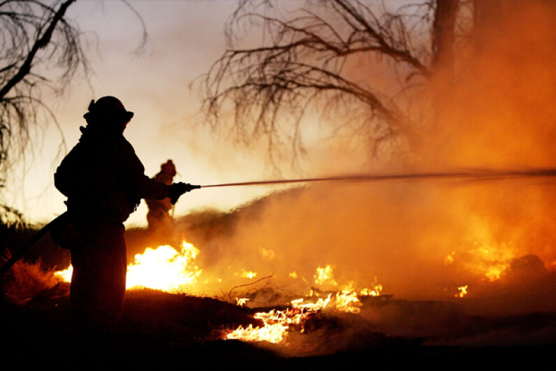 Firefighters battle the Woodhouse fire, also being called the Calimesa fire, in San Timoteo Canyon on Oct. 6, 2005, near Calimesa, California. David McNew/Getty Images