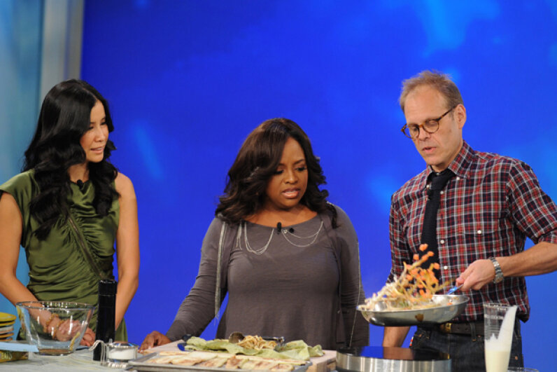 """Alton Brown, right, as a guest cook on """"The View"""" in 2009. Steve Fenn/ABC/Getty Images"""