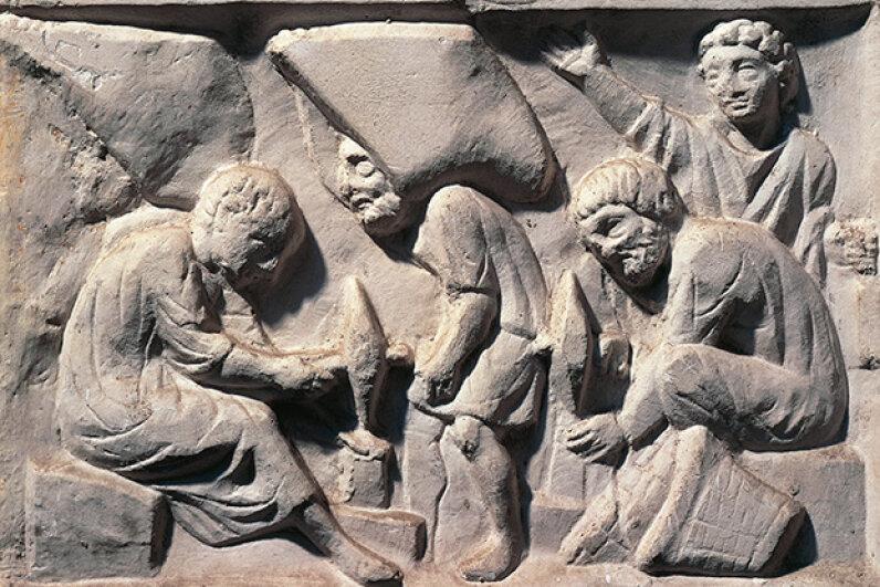 Stonecutters at work in ancient Rome. DEA / A. DAGLI ORTI/De Agostini/Getty Images