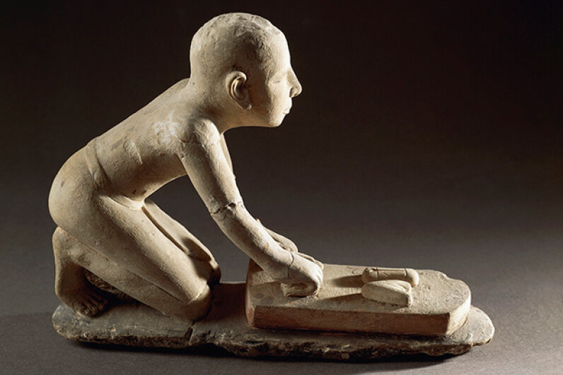 This Egyptian figurine from around 3500 B.C.E. shows a baker at work. DEA / G. DAGLI ORTI/Getty Images