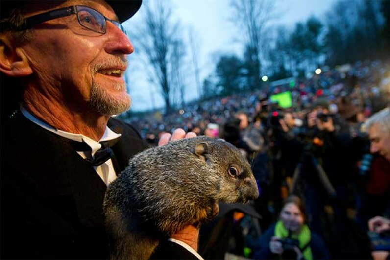 Groundhog handler Ron Ploucha holds Punxsutawney Phil after he saw his shadow predicting six more weeks of winter during the 126th annual Groundhog Day festivities on Feb. 2, 2012 in Punxsutawney, Pennsylvania. Phil was right that year, for a change. Jeff Swensen/Getty Images