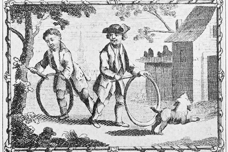 Two American boys in Colonial times play with hoops -- and their dog. © Bettmann/CORBIS