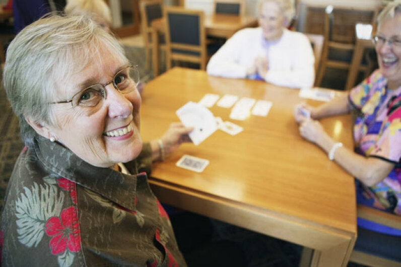 Grandma could be a dangerous criminal if she keeps playing cards on Sunday in Alabama. Brand X Pictures/Thinkstock