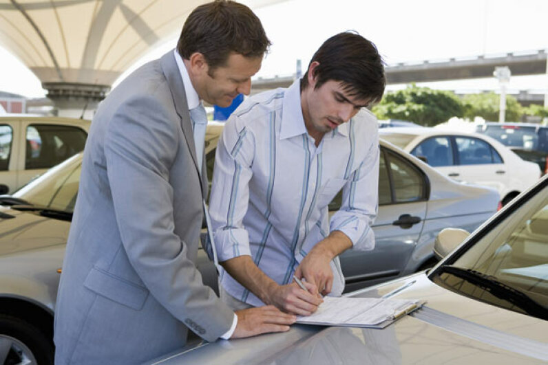 """Just sign where it says 'soul.'"" Is there something diabolical about buying cars on Sundays (apart from the shady salesmen)? Jupiterimages/Pixland/Thinkstock"