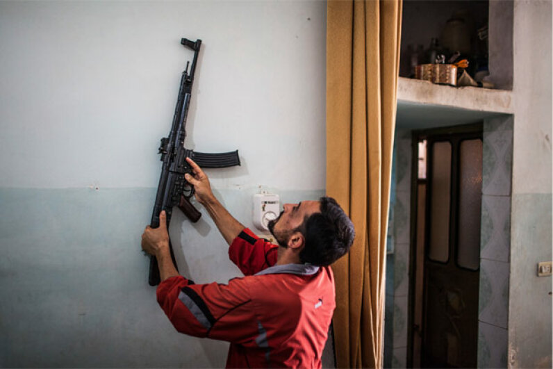 August 2012: A Sturmgewehr 44 hangs on the wall of a home in Tal Rifaat, Syria. According to some reports, Syrian rebels found thousands of the World War II-era weapons in a large warehouse. © Bryan Denton/Corbis