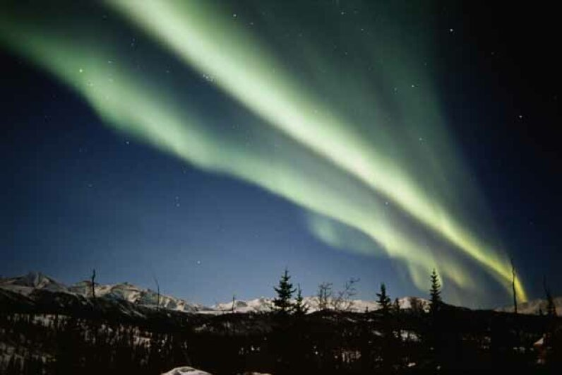 Denali National Park falls well within the Northern Lights zone. Tom Walker/The Image Bank/Getty Images