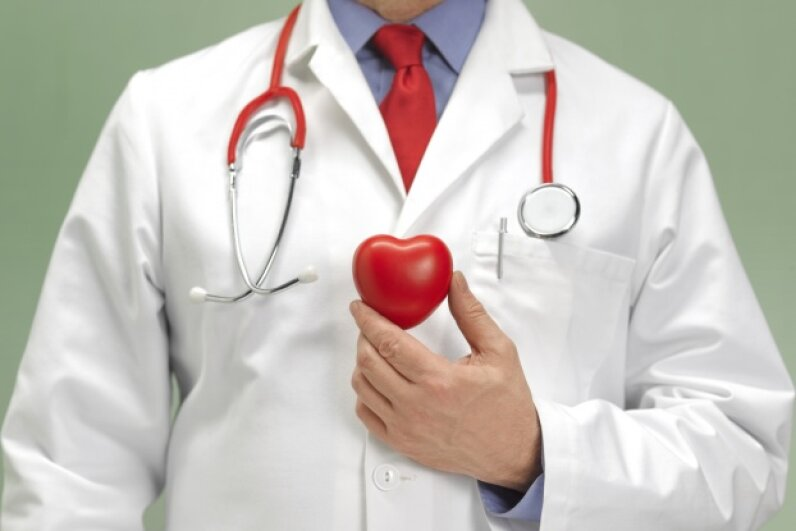 Doctor holding plastic toy heart