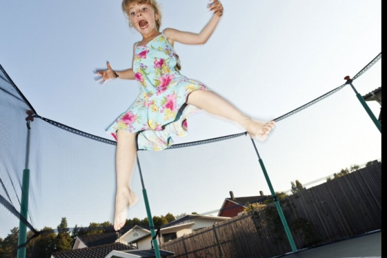 Trampolines can be fun, but you have to be aware of potential dangers. Get an enclosure, stick to one person jumping at a time, and always supervise children.   ©iStockphoto/Thinkstock