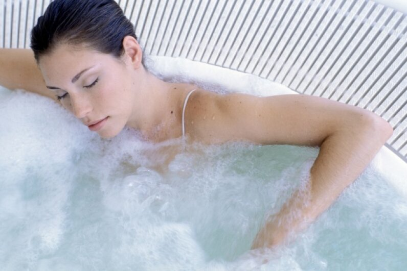 Keep your hot tub time down to 15 minutes or so, and never allow yourself to doze off. ©Pixland/Thinkstock