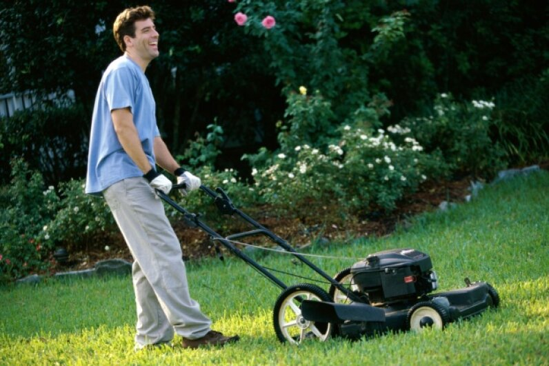 Even when it's hot out, resist the temptation to wear shorts when mowing the lawn. ©Purestock/Thinkstock