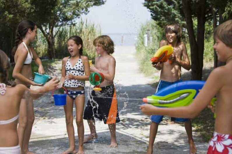 Water games are so much fun! See pictures of classic toys and games. Jupiterimages/Comstock/Thinkstock
