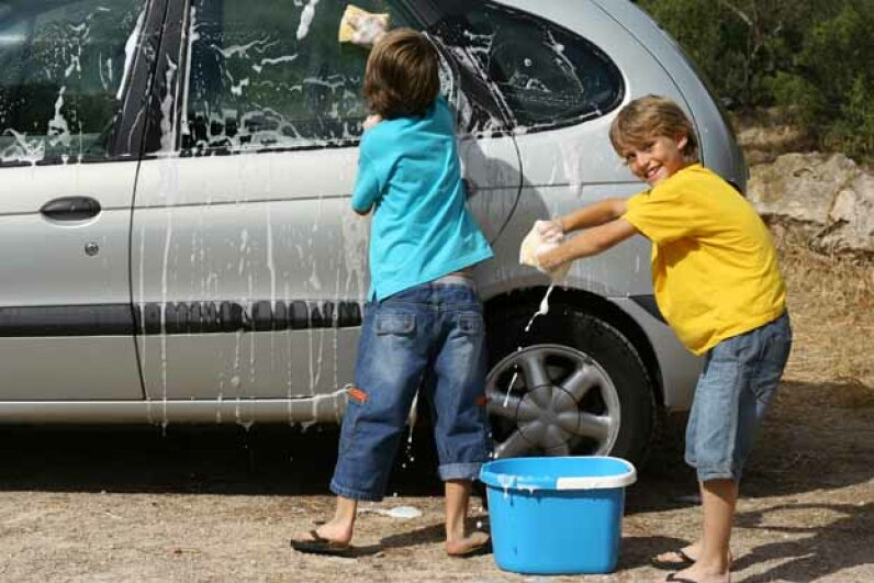 After your kids play sponge splash, have them use their bucket and sponge in another fun game -- washing Mommy's car. iStockphoto/Thinkstock