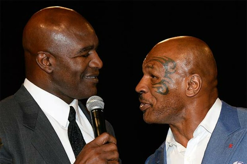 Decades after Mike Tyson took a bite out of Evander Holyfield's ear during a fight, Tyson inducted Holyfield into the Nevada Boxing Hall of Fame in 2014. The two former boxers share something else in common: Both have declared bankruptcy Ethan Miller/Getty Images