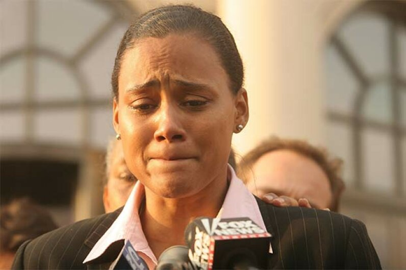 Marion Jones speaks to the media outside a U.S. federal courthouse in 2007 in White Plains, N.Y. after pleading guilty to charges in connection with steroid use. Hiroko Masuike/Getty Images
