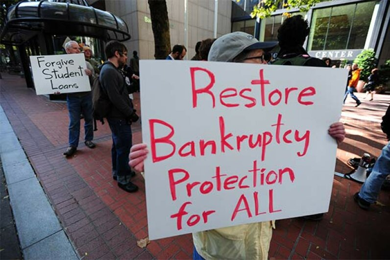 Protesters demand that student loan debt be cancelled if bankruptcy is declared. So far, the U.S. government hasn't changed their mind on that issue. © Alex Milan Tracy/Demotix/Demotix/Corbis