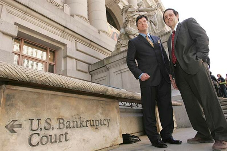 Bill Bubbers (left) and Tony Christ of Loral Space and Communication stand in front of the U.S. Bankruptcy courthouse in New York City. © Najlah Feanny/Corbis