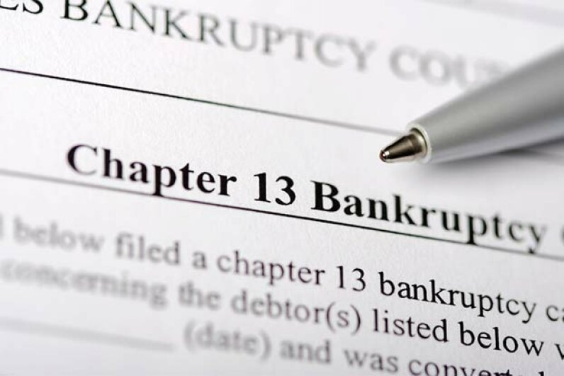 If the bankruptcy court determines you have enough disposable income to pay back some of your debts, you can't file Chapter 7; you must file Chapter 13. Michael Martin/Getty Images