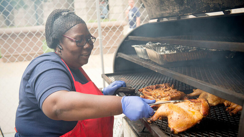 Mary Simon owner of Mama Mary's BBQ prepares chicken for judges at the National Capital Barbecue Battle in 2014. Her grill allows her to do direct and indirect grilling. Marvin Joseph/The Washington Post via Getty Images