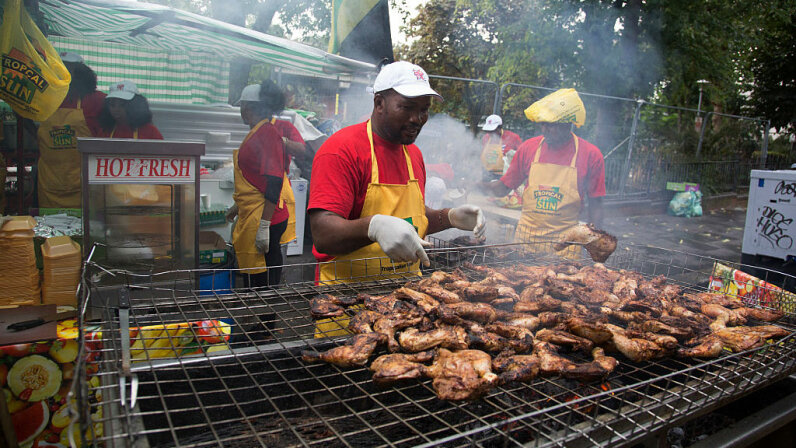 Cooks make Jamaican-style jerk chicken at the Notting Hill Carnival in London. Mike Kemp/In Pictures via Getty Images