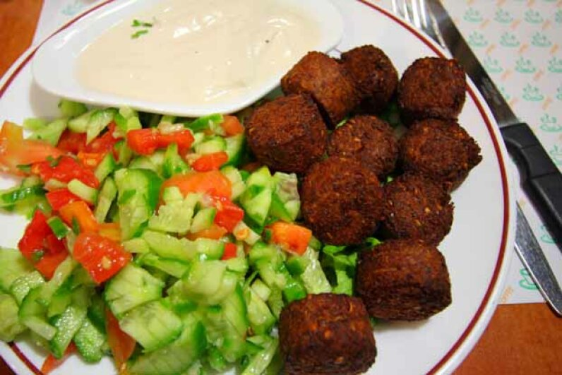 A plate of falafel accompanied by some salad and hummus makes a great meal. Weimin Liu/Monument/Getty Images