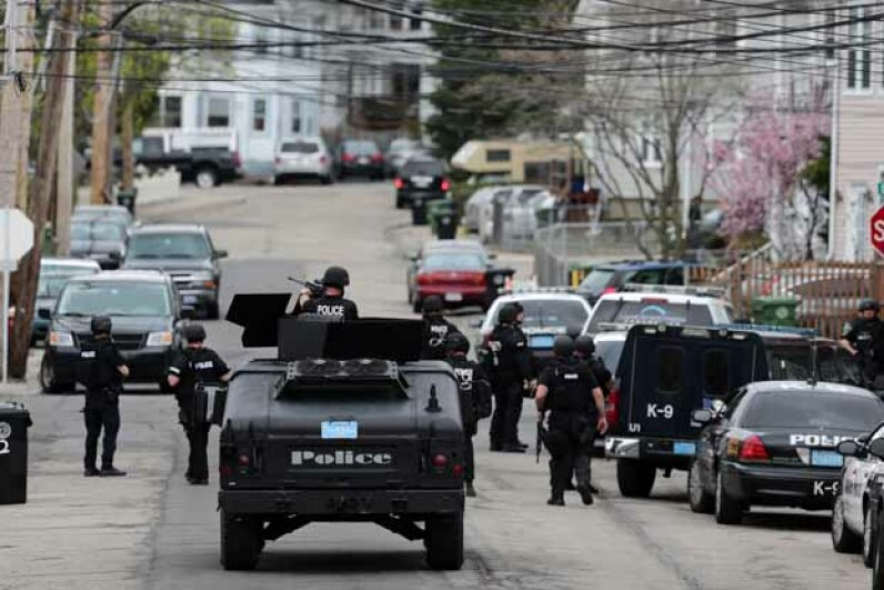 S.W.A.T. teams conduct a house-to-house search during the manhunt for a suspect in the terrorist bombing of the 117th Boston Marathon. See more police pictures. Barry Chin/The Boston Globe via Getty Images