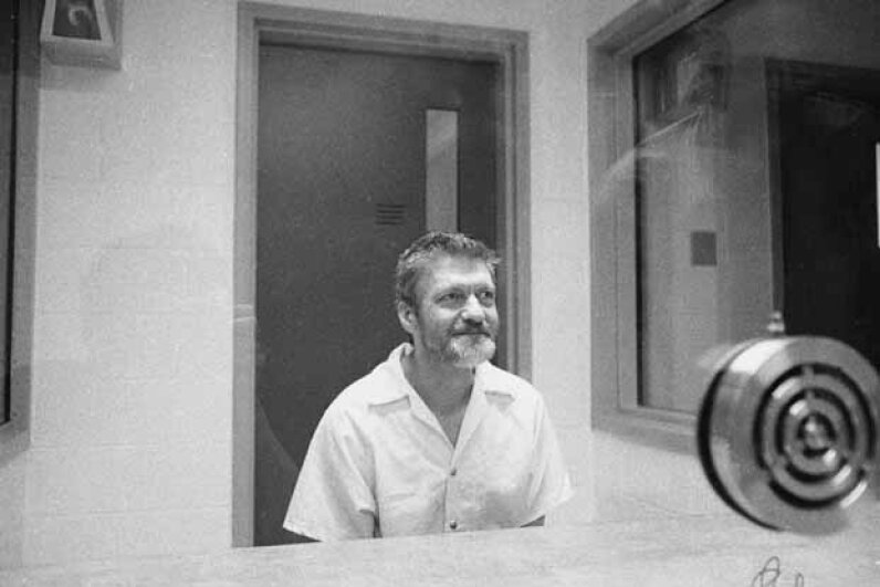 Ted Kaczynski sits and smiles during an interview in a visiting room at the Federal ADX Supermax prison in Florence, Colo., 1999. Stephen J. Dubner/Getty Images