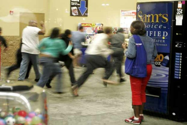 Shoppers sprint through the doors of a Miami Wal-Mart as it opens at 5 a.m. on Black Friday in 2005. Carlo Allegri/Getty Images