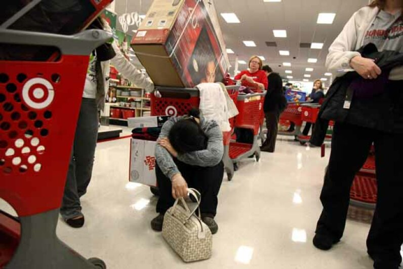 Trinh Pham, 22, of Arlington, appears exhausted as she waits in line at a Target in Allen, Texas on Thanksgiving night, 2010. © David Woo/Dallas Morning News/Corbis