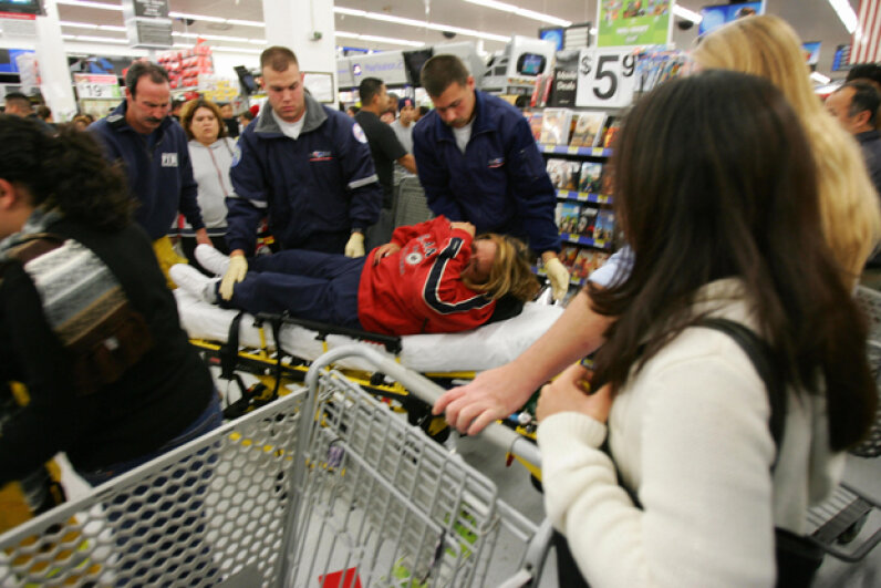 Paramedics help a shopper who fell shortly after the doors opened at 5 a.m. on Black Friday, 2005 at the Wal-Mart in Duarte, Calif. ROBYN BECK/AFP/Getty Images
