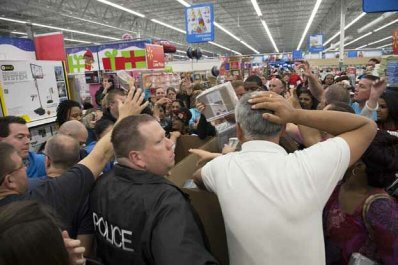 Shoppers who couldn't wait until midnight jostle and grab for cotton sheets at a Wal-Mart store shortly before 8 p.m. on Thanksgiving. © Robin Nelson/ZUMA Press/Corbis