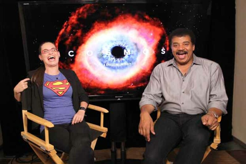 Astrophysicist/author Neil deGrasse Tyson (R) shares a laugh at Comic-Con in San Diego, California in 2013. Jonathan Leibson/WireImage/Getty Images