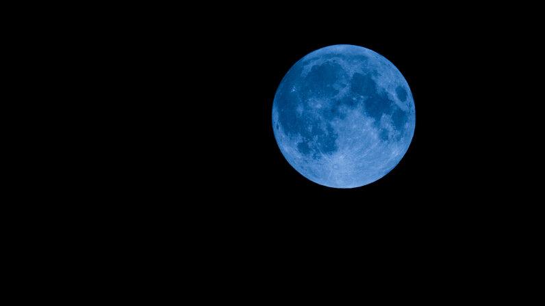 blue moon on black sky