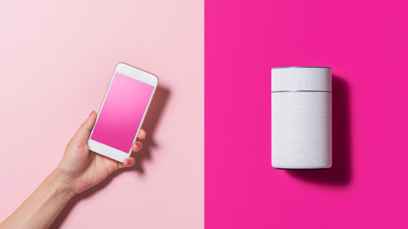 smartphone and smart speaker on pink background