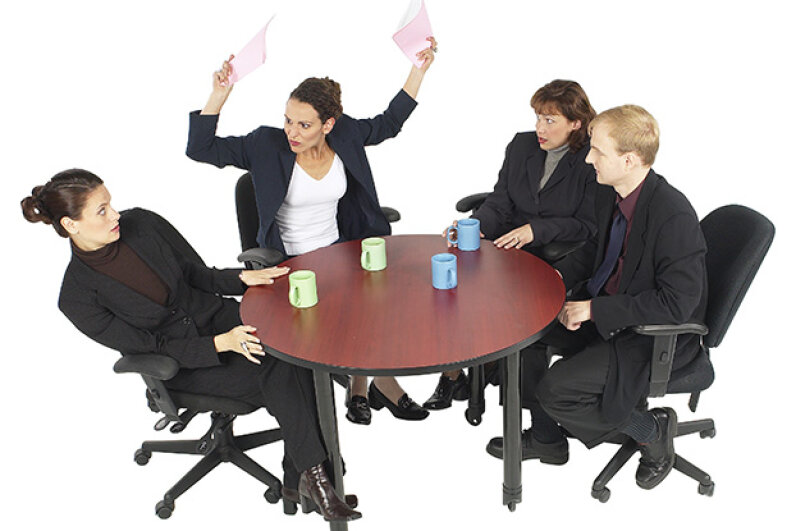 Scolding an employee in front of others is so bad for morale. Hemera Technologies/PhotoObjects.net/Thinkstock