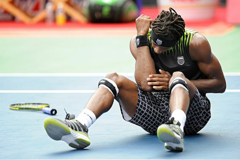 Gael Monfils of France checks his elbow after falling trying to reach a return against Rafael Nadal of Spain during a men's singles final match in Japan in 2010. You can get tennis elbow from other activities besides tennis. TORU YAMANAKA/AFP/Getty Images