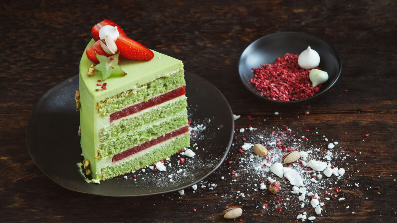 This lovely pistachio sponge cake has a strawberry filling. Sponge cakes use egg whites, rather than baking powder, as leavening agents. Eugene Mymrin/Getty Images