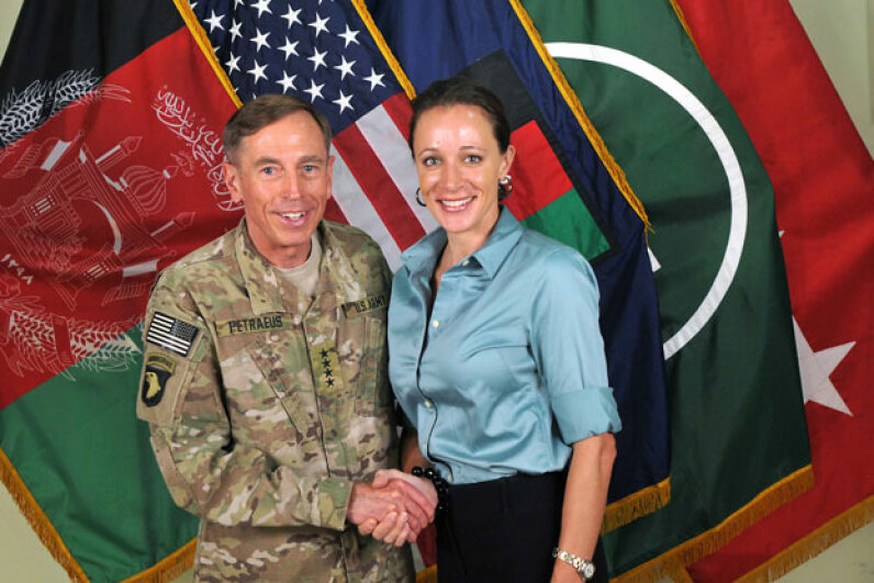 A July 13, 2011 photograph of Gen. Davis Petraeus shaking hands with his biographer and paramour, Paula Broadwell.  © ISAF via Getty Images