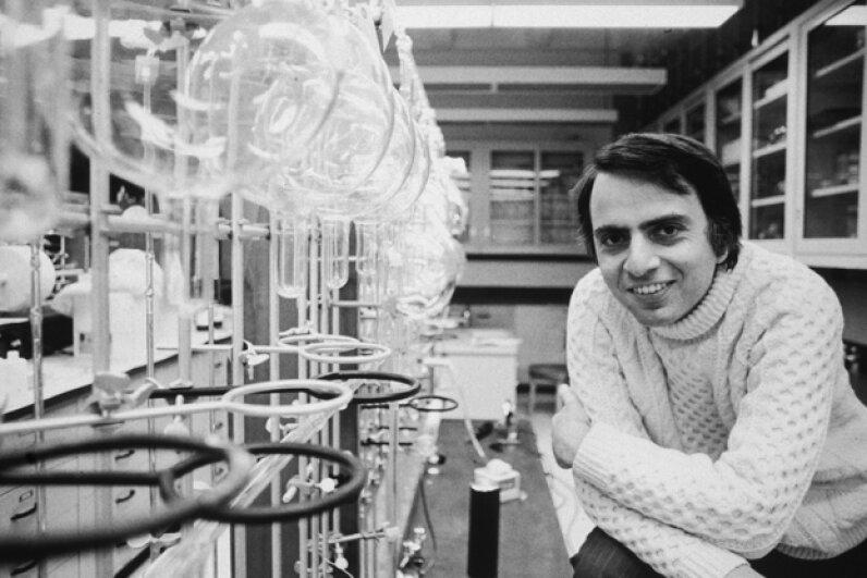 Carl Sagan wears his trademark turtleneck sweater in a laboratory at Cornell University, Ithaca, N.Y. in 1974. Santi Visalli Inc./Getty Images