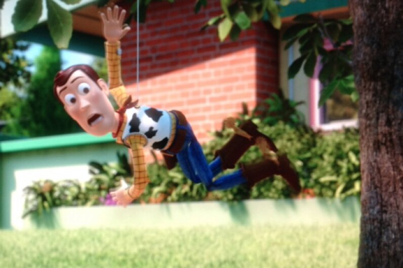 Woody's pull string counteracts gravity. Take that, gravity! Screen capture by HowStuffWorks staff
