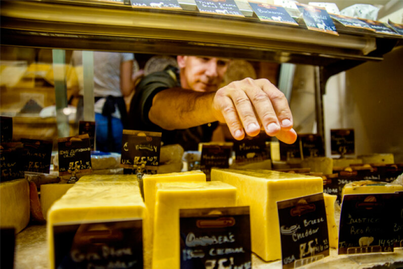 The only way a cheesemonger can help customers make the perfect selection is by tasting and knowing every cheese inside and out. Sue Barr/Getty Images