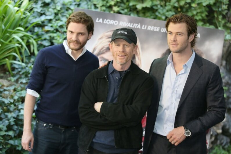 "Ron Howard in Italy promoting his film ""Rush"" with actors Daniel Bruhl and Chris Hemsworth in September 2013. © Ernesto Ruscio/WireImage"