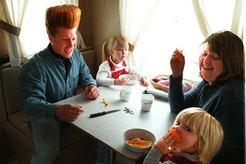 Big Apple Circus clown Bello Nock dines with his wife Jenny and their two daughters in their trailer. Tom Herde/The Boston Globe via Getty Images
