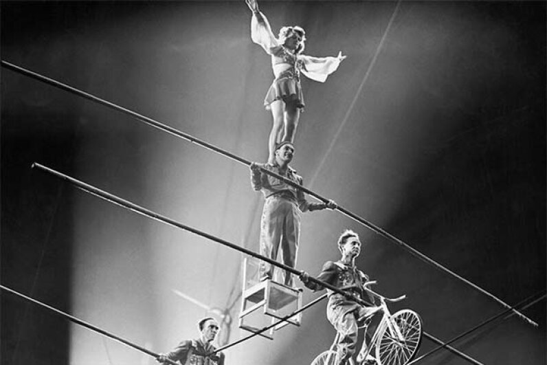 The Flying Wallendas perform a four-person pyramid in the 1940s. © Corbis