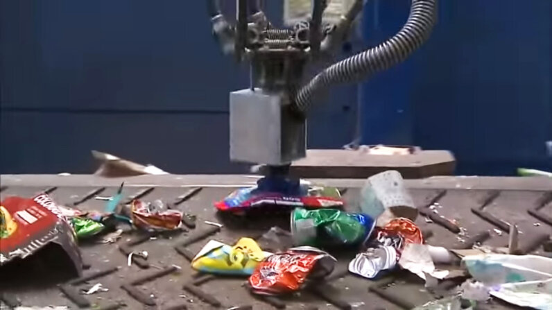 An AMP Robotics creation nicknamed Clarke was built to sort cartons in a recycling setting. Clarke's artificial intelligence programming allows it to learn more efficient ways of performing its task. WCCO - CBS Minnesota/YouTube/Screenshot: HowStuffWorks