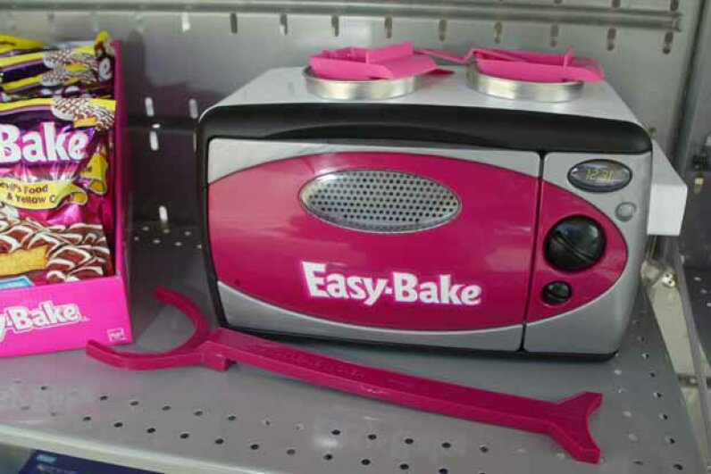 The current Easy-Bake Oven bears little resemblance to the model with the cooktop and front-loading oven that caught so many little fingers. Matthew Simmons/WireImage for Silver Spoon