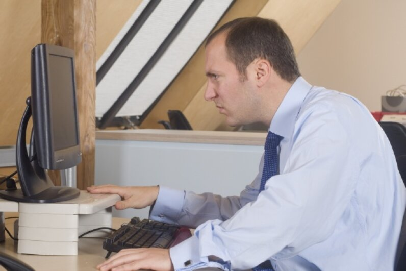 That guy needs to be freed from his desktop. The cloud can help with that. Ingram Publishing/Thinkstock
