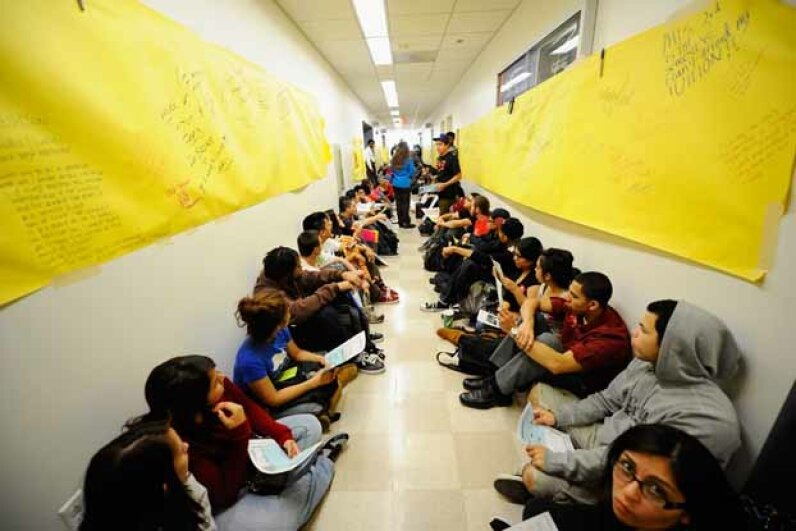 Students and faculty members staged a sit-in in front of the president's office at California State University, Northridge, protesting proposed budget cuts in 2011. Several theories have been proposed for the high increase in college costs. See more college pictures. Kevork Djansezian/Getty Images