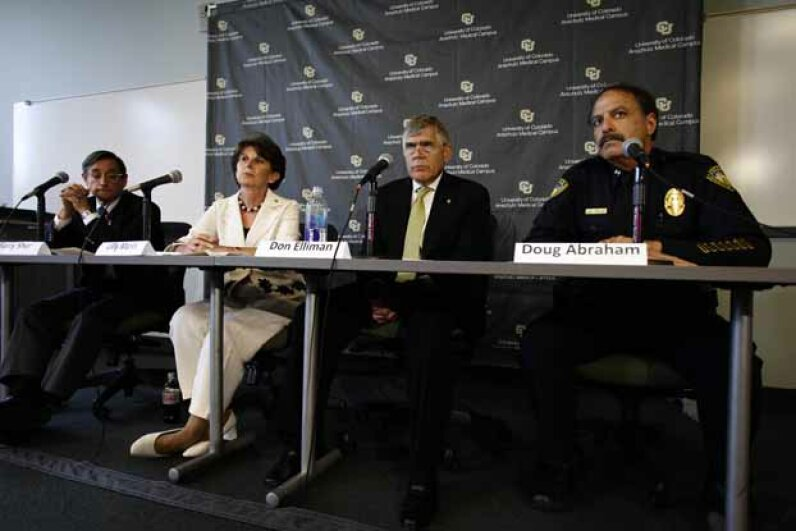 University of Colorado Anschutz Medical Campus Dean of the Graduate School Barry Shur (left), Executive Vice Chancellor Lilly Marks, Chancellor Don Elliman and Police Chief Doug Abraham speak during a 2012 news conference in Aurora, Colo. Photo by Joshua Lott/Getty Images